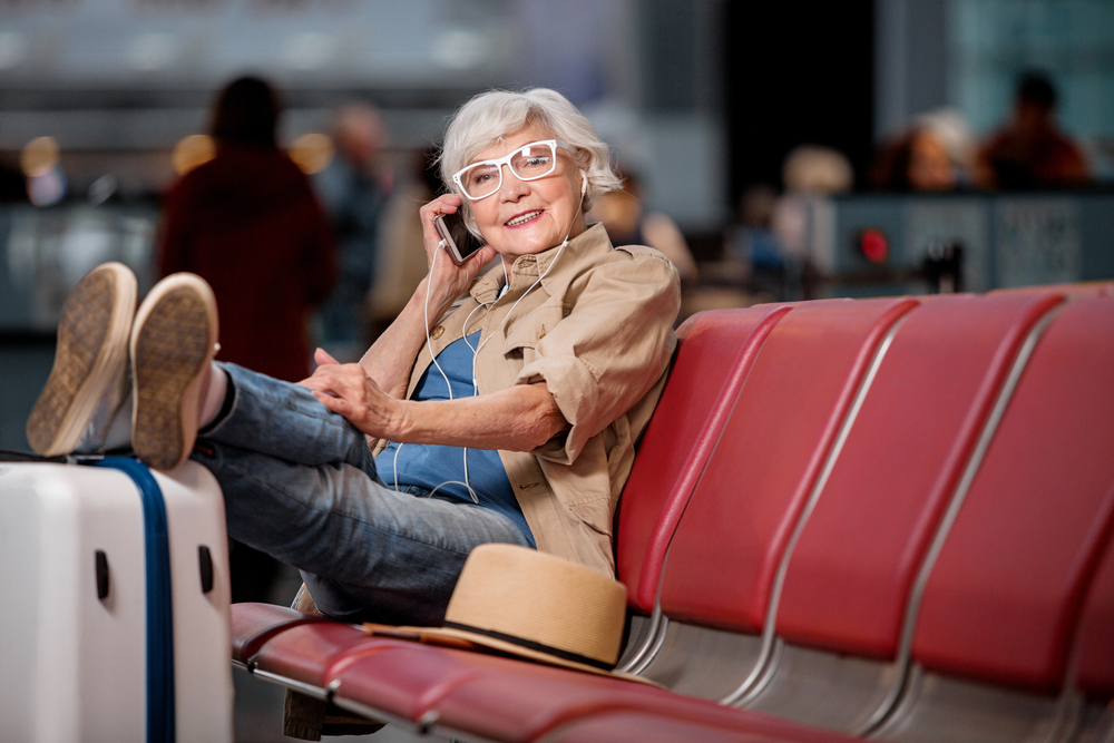 solo senior travel tips lady and her luggage