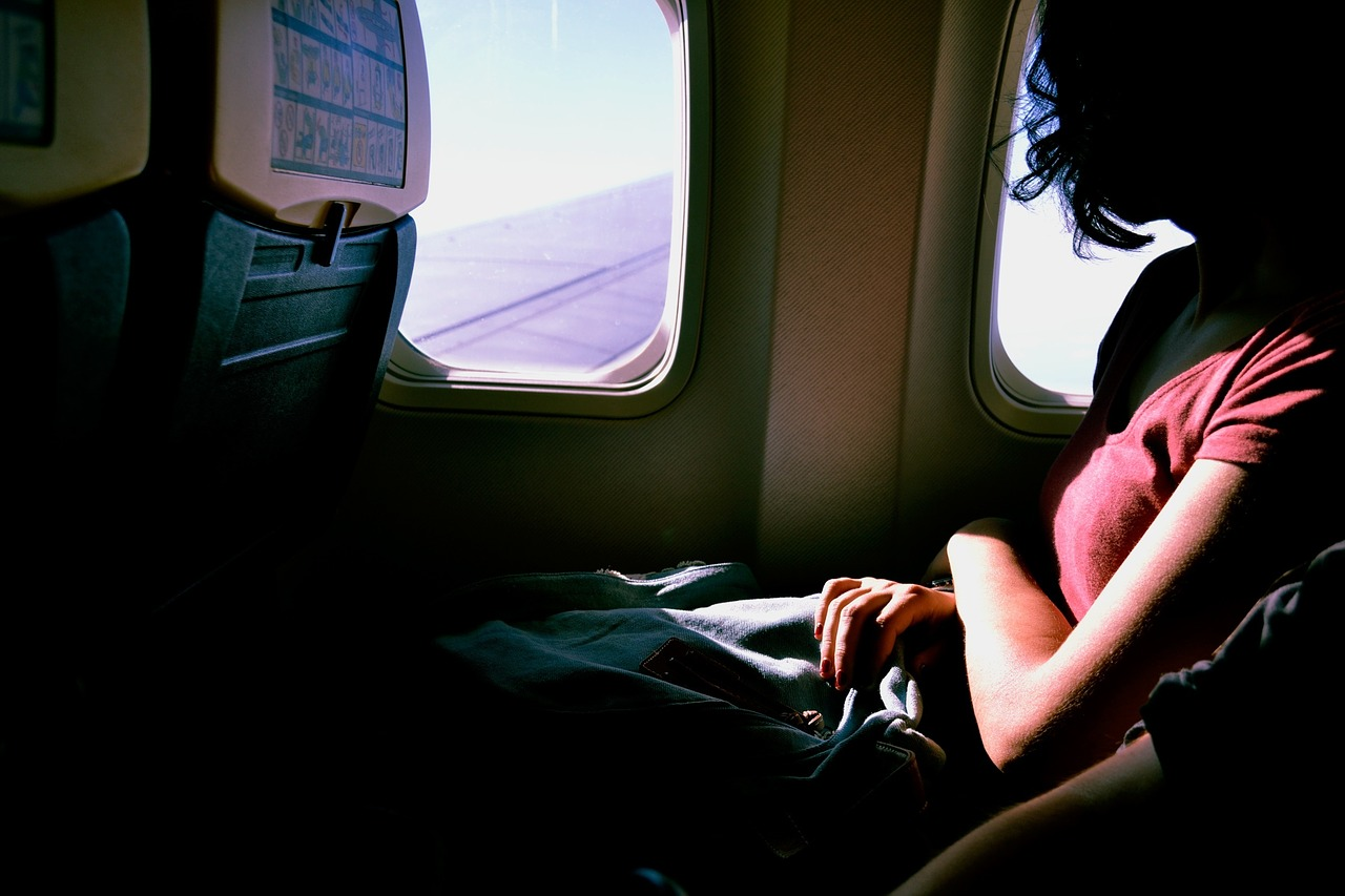 lomg international flight girl reading window