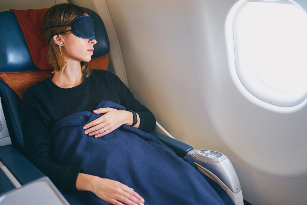 surviving long international flights sleeping during flight