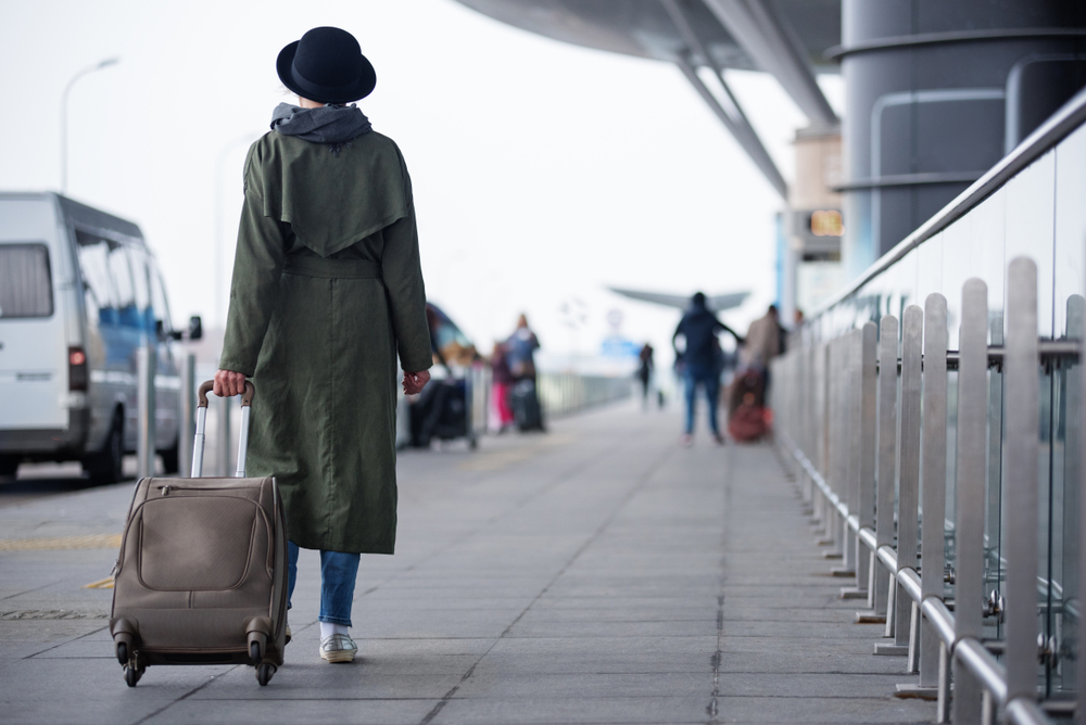 how to pack lightly woman with suitcase