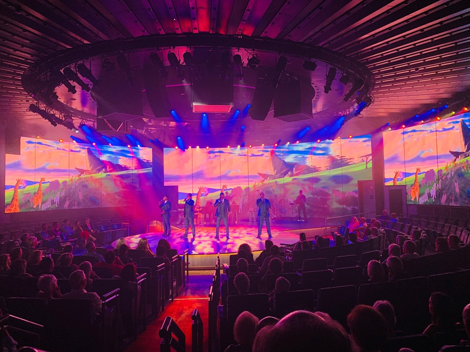 Holland America Mediterranean Cruise Vox Fortura performing on an brilliantly lighted stage