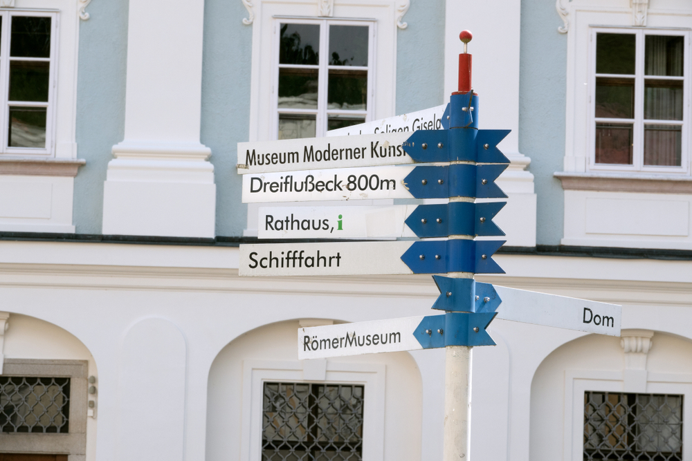 Signs pointing to various attractions in Passau Germany