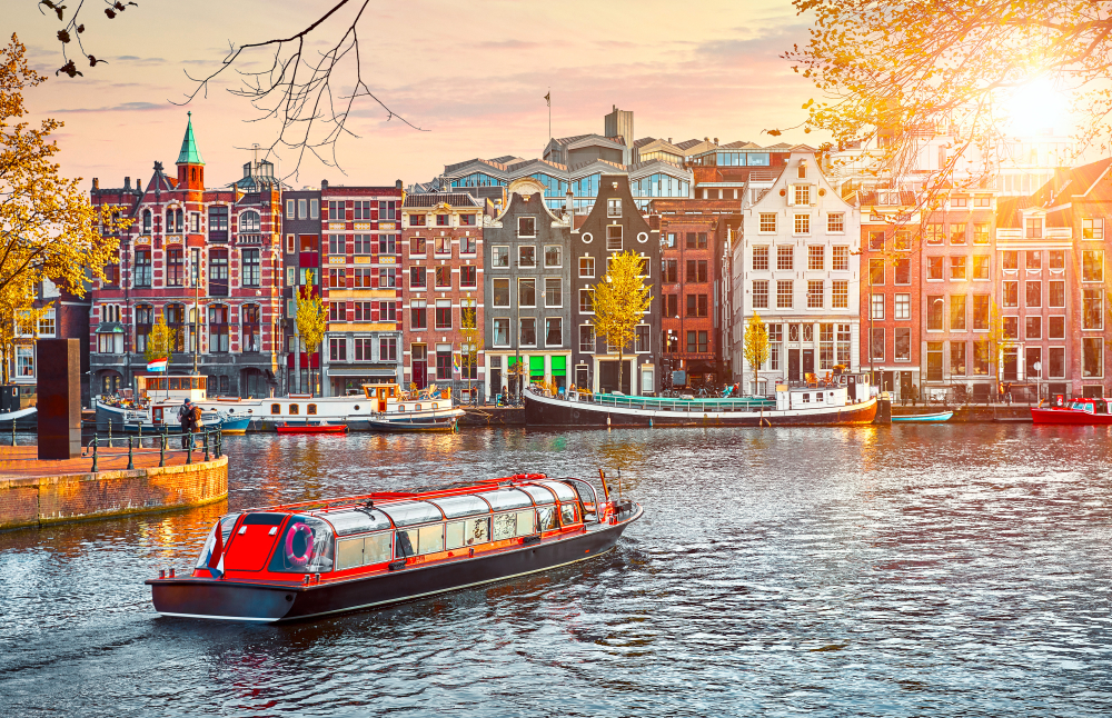 Make sure to take a canal tour of Amsterdam when traveling to Amsterdam