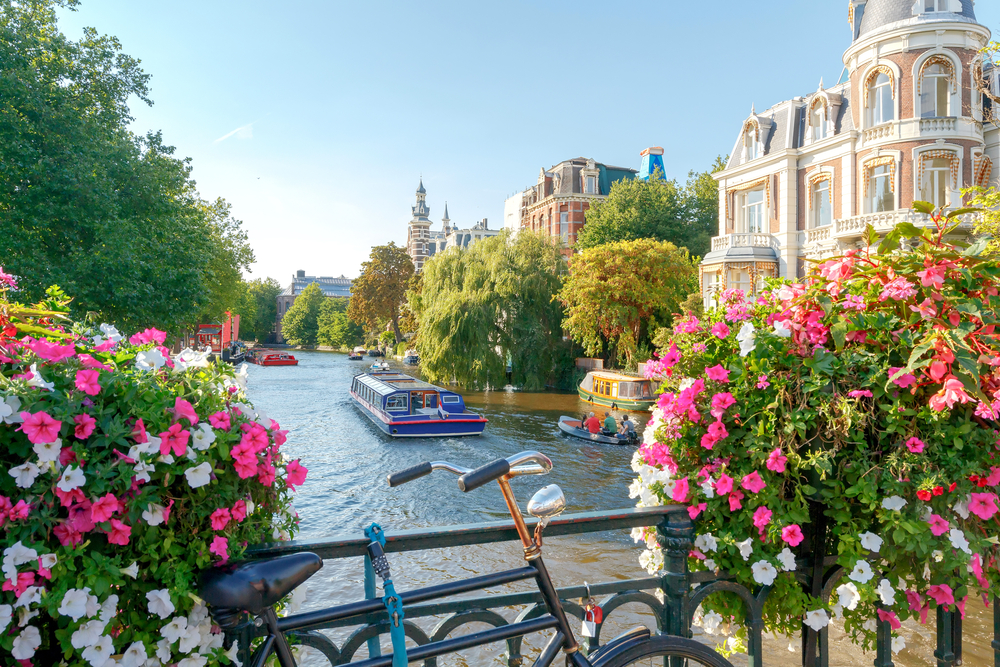 When traveling to Amsterdam you will see beautiful canals and bright buildings
