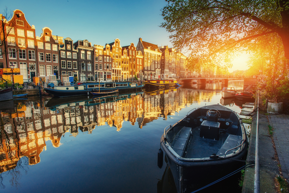 When traveling to Amsterdam you will see beautiful sunsets over the canals