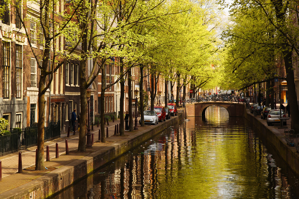 What beautiful quiet canal streets you can stroll when traveling to Amsterdam