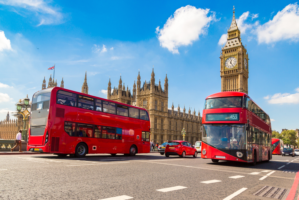 Big red busses with top decks provide panoramic views during your first time in London