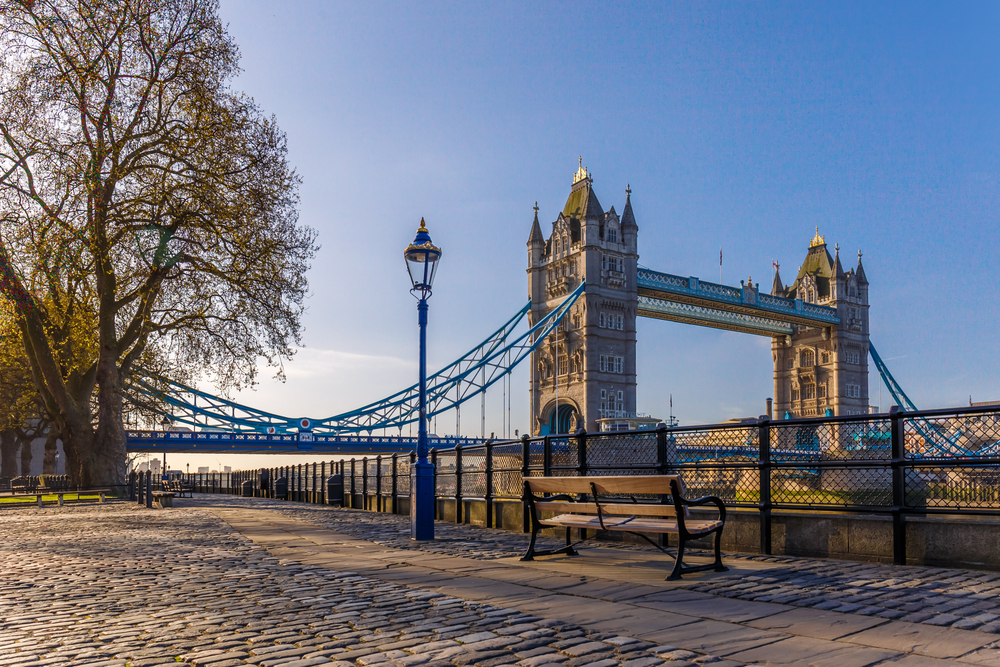 A beautiful street view of the Tower Bridge can be seen during your first time in London
