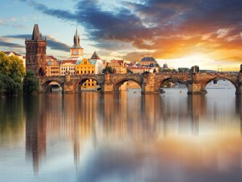 When traveling to Prague make sure to see a sinset over the Vltava River