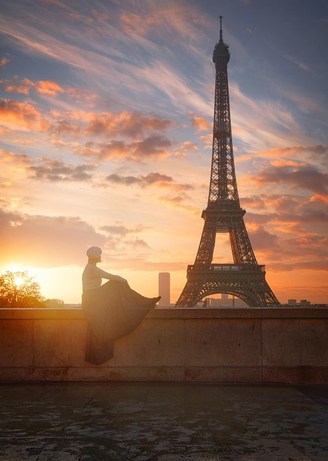 sitting at the Trocadero watching the sunrise over the Eiffel Tower