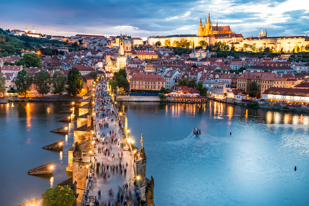 The charles bridge at night is a festival like place in Prague