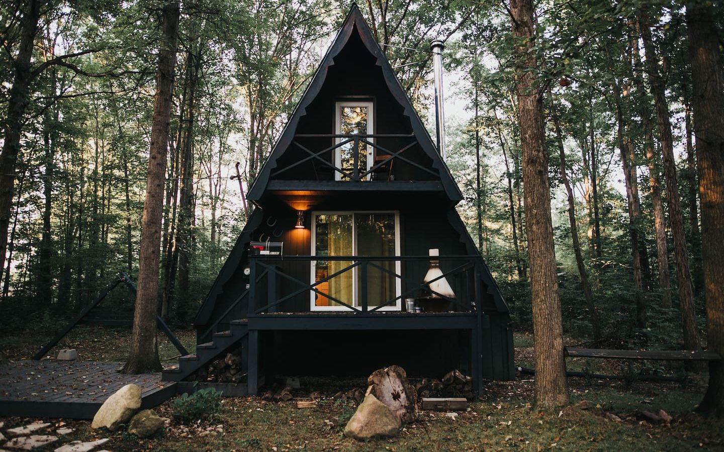 black a-frame style cabin in the forest cabins in Oahu