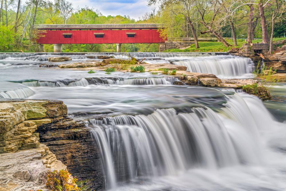 Red Cataract Bridge over rushing stream in Indiana