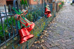 red Christmas bells tied to gate Christmas in Ohio