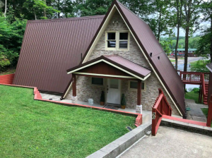 gray rock A-frame with brown roofing