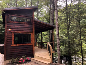 worn cabin over tree-filled overlook