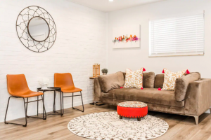 living room with red accents best Airbnbs in Columbus