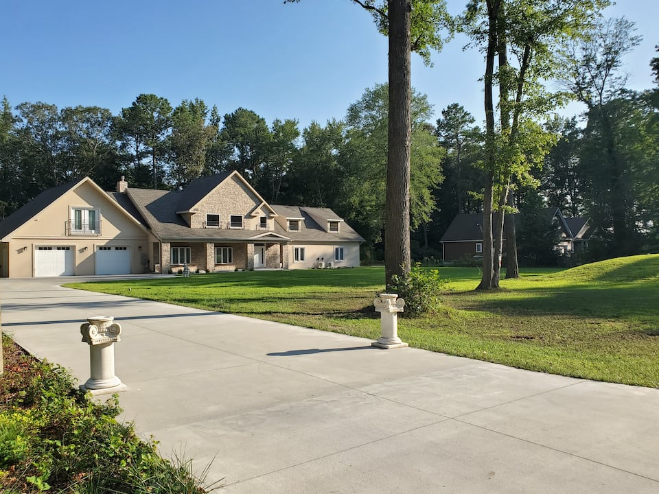 Beautiful contemporary home with large cement driveway and treed yard.