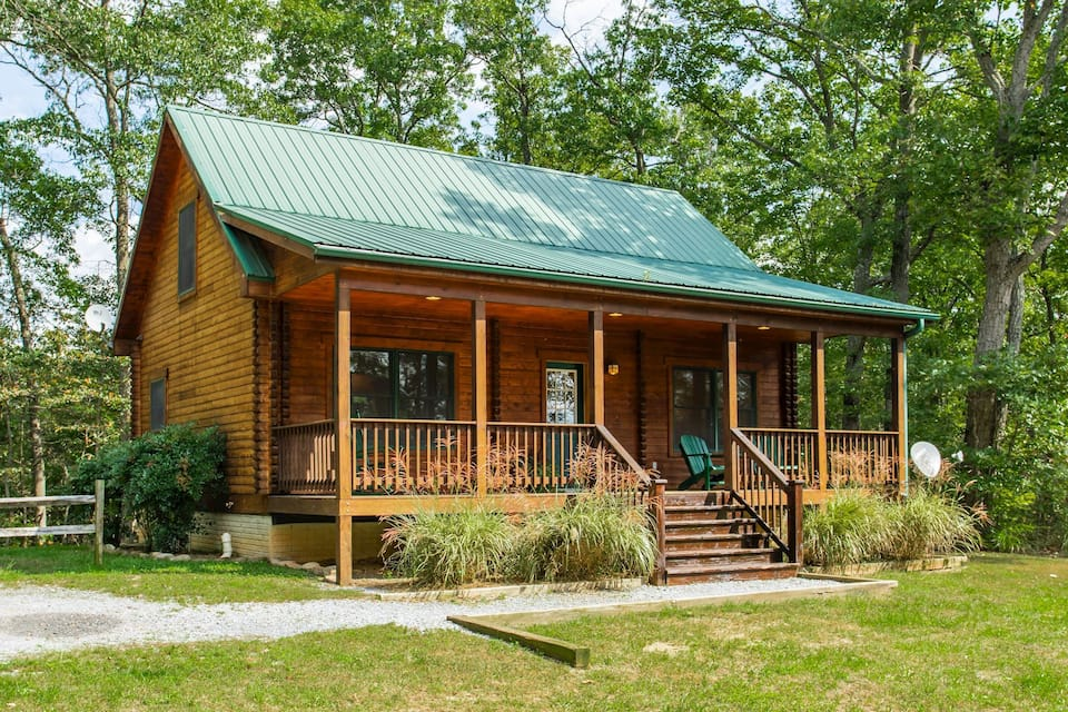 One of the cozy cabins in Virginia with green tin roof, beautiful balcony and landscaping
