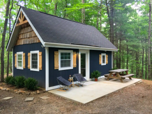 dark blue exterior of home with white paneled windows Airbnbs in Virginia