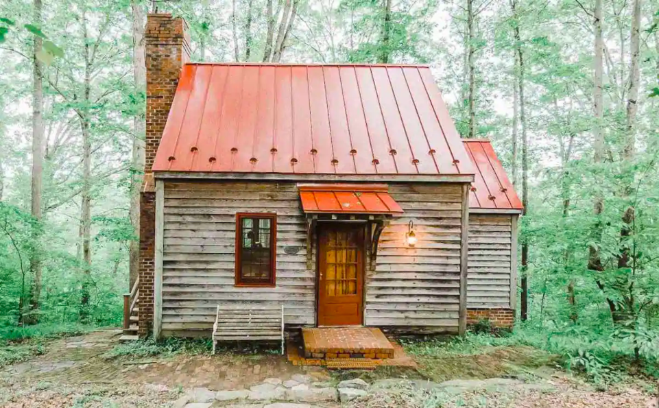 adorable run down cabin with orange metal roof makes it one of the coziest cabins in Virginia.