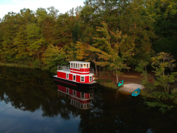 red and white tugboat in lake