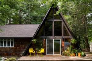 A-line cabin with pair of bright yellow chairs on front porch cabins in Pennsylvania