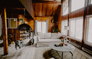 living room in cabin with bright white couch