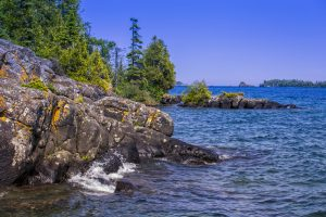 blue waters on rocky shoreline national parks in the Midwest