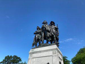 metal statue of three people