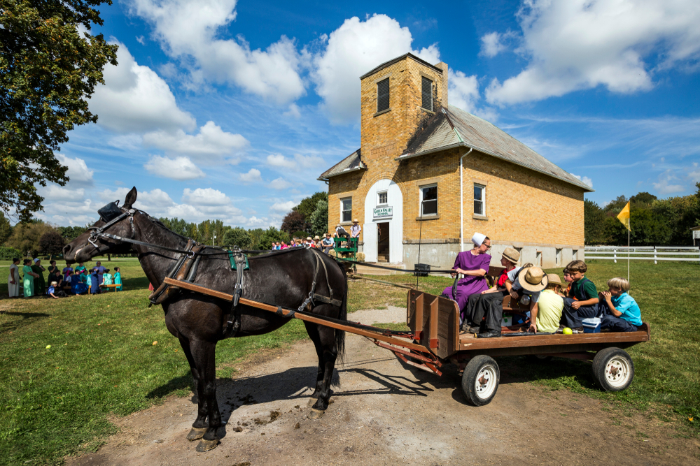 An Amish building in Ohio with Amish people around it