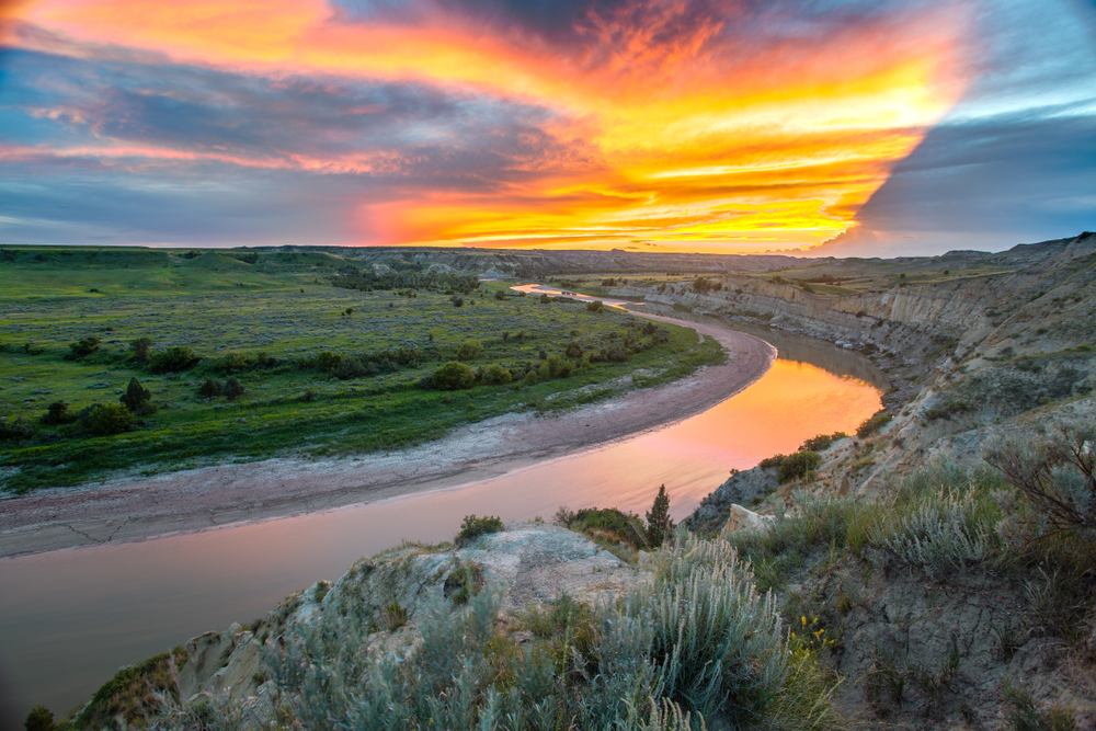 Sunset on North Dakota with river winding through the countryside.