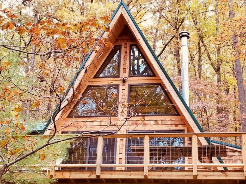 This A-frame cabin in West Virginia has large windows and 360 degree views from its large deck.