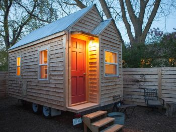 Photo of tiny cabin with light streaming outside.