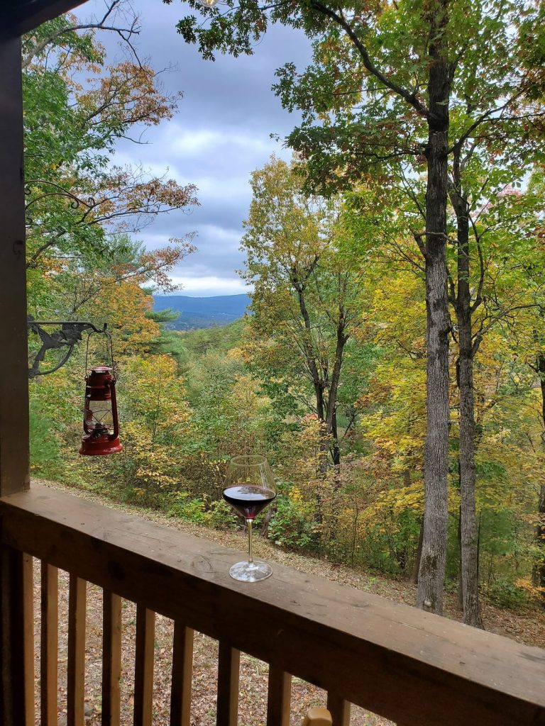 Sweeping view of Shenandoah Valley from deck. Red lantern and glass of wine in foreground.