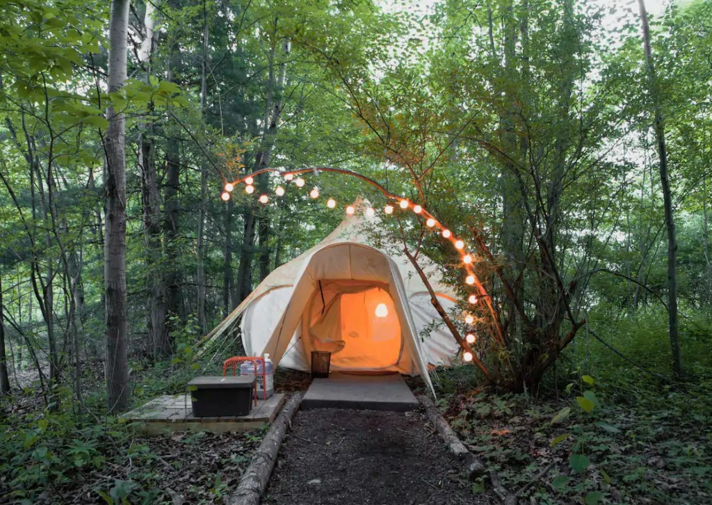 Charming yurt with string of lights surrounding it is one of the coolest glamping in Ohio selections!