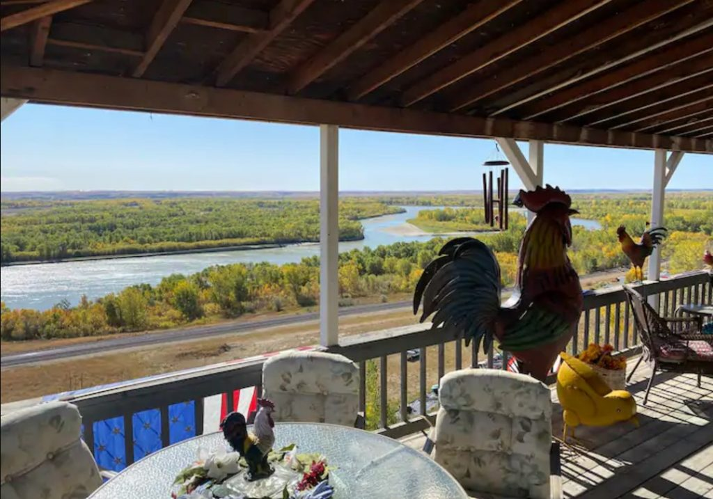 Sweeping views of the Missouri River and surrounding wilderness on the porch of one of the best Airbnbs in North Dakota