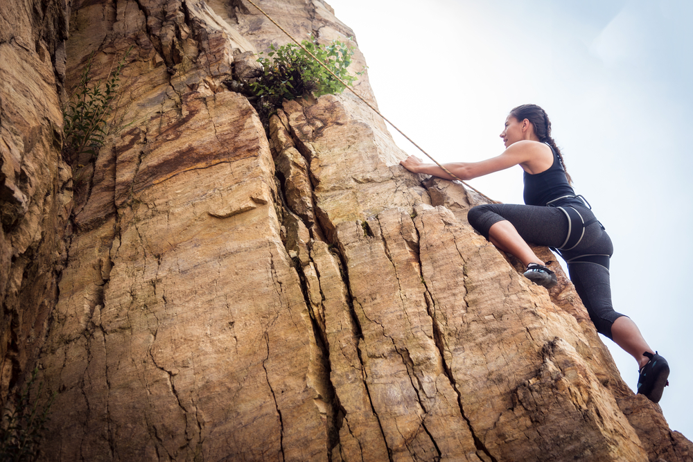 a girl rock climbing