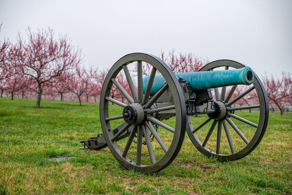 Gettysburg cannon with trees in background, a historical town in PA.