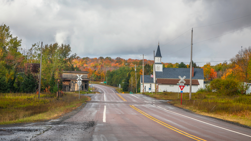 An old church and level crossing in Covington