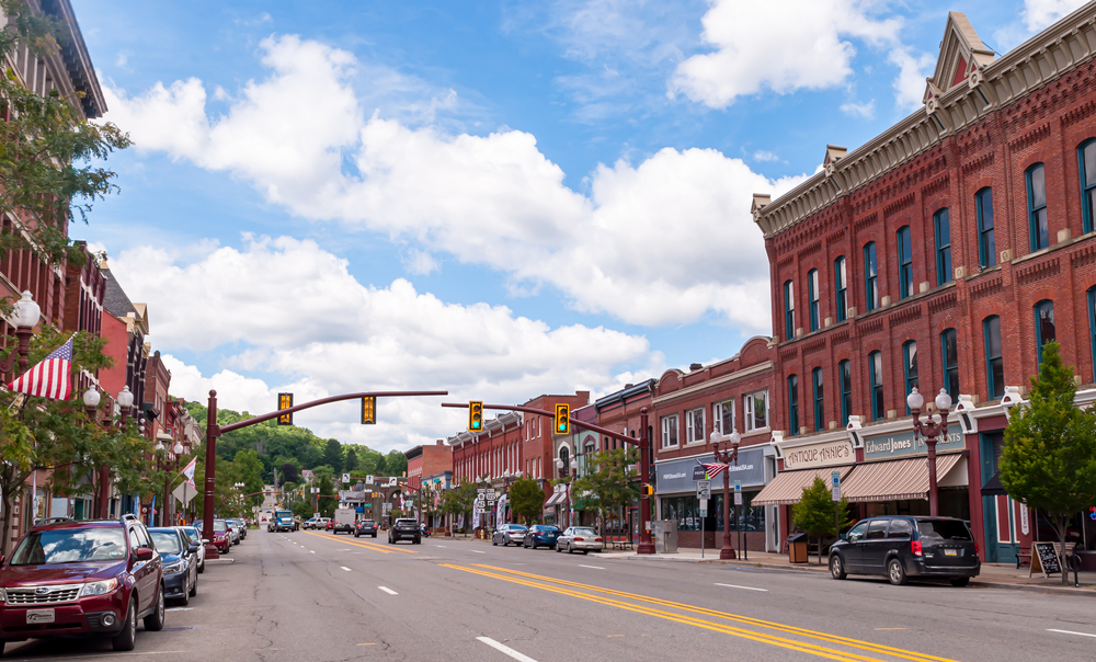Picturesque downtown Franklin, a small PA town with red brick vintage building and cars parked in street.