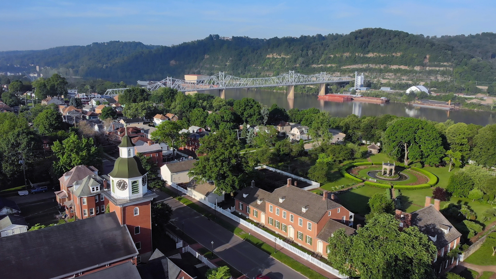 an aerial shot of a town in Pennsylvania, Ambridge with the Ohio River and rolling hills in background.