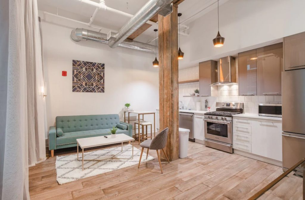 The small living area and fully equipped kitchen in a modern condo in Cincinnati Ohio with Art Deco décor is a great VRBO in Ohio
