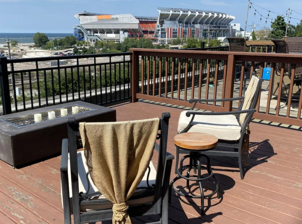 The balcony with views of Lake Erie, FirstEnergy Stadium, and the docks of Cleveland.