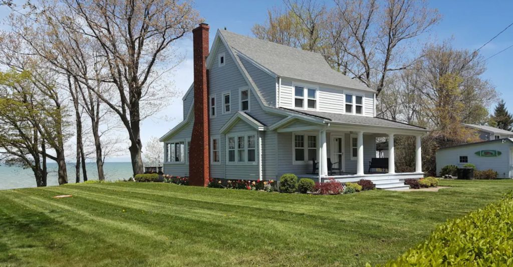 The exterior of a large Lake Erie beach cottage in the spring, VRBO in Ohio