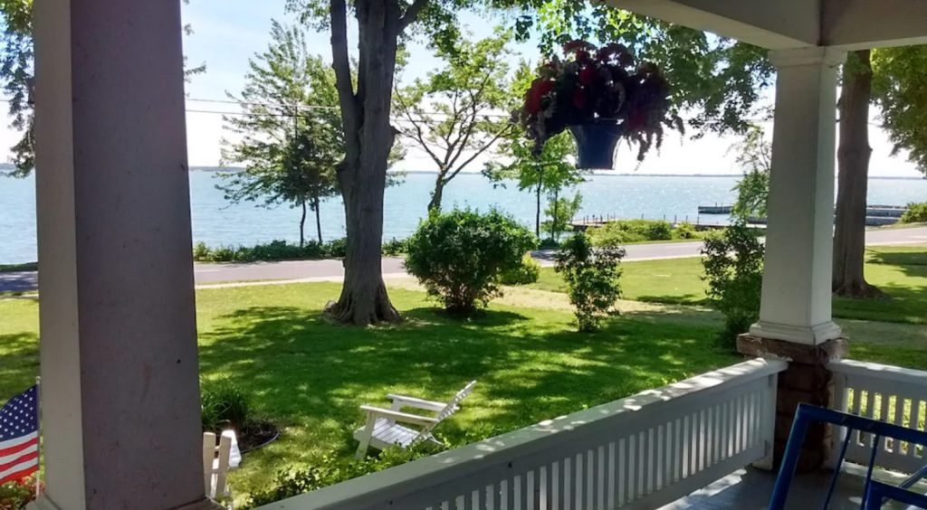 The view of Lake Erie from the front porch of a Lakefront Bungalow in Ohio on a sunny day
