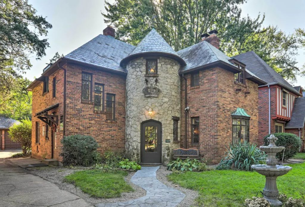 The exterior of a home styled like a castle in Toledo Ohio on a sunny day