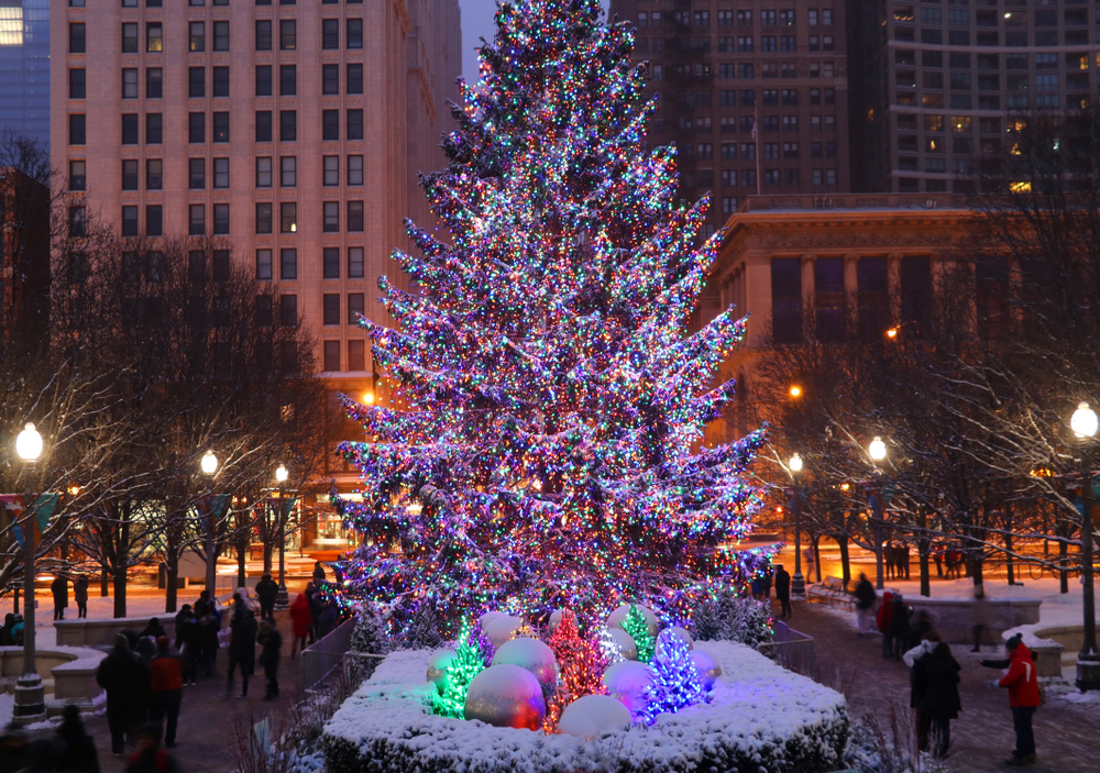 A beautiful Christmas tree in Chicago in front of buildings