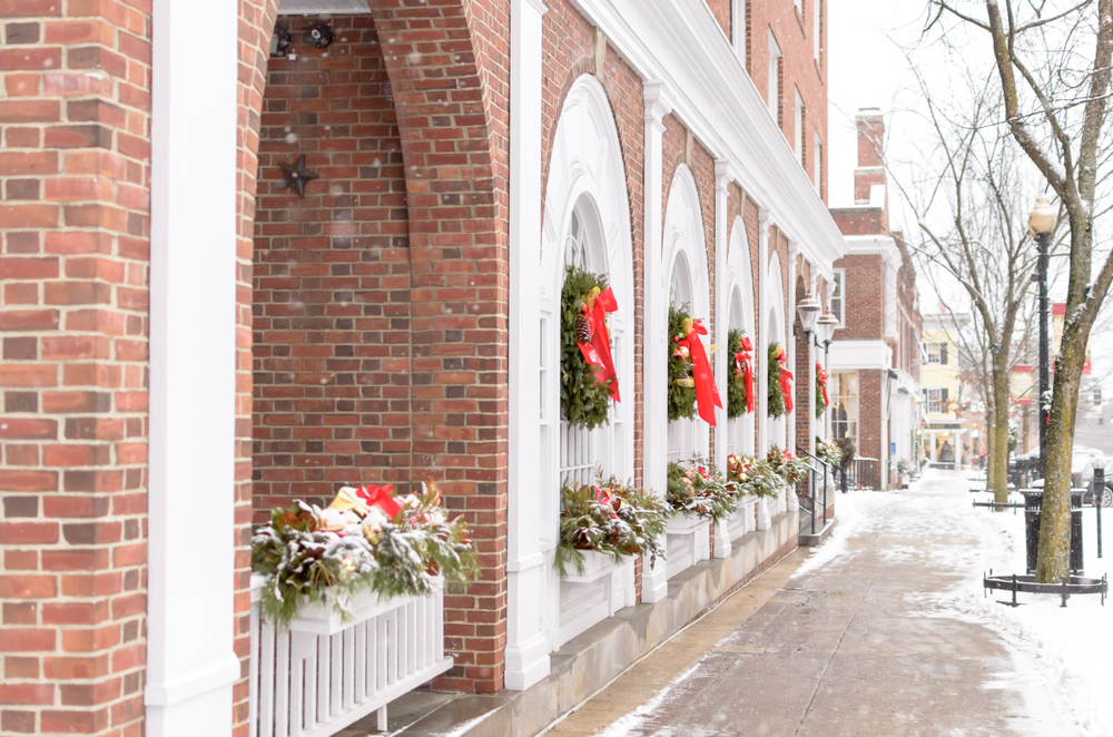 Red bows on a snow covered building