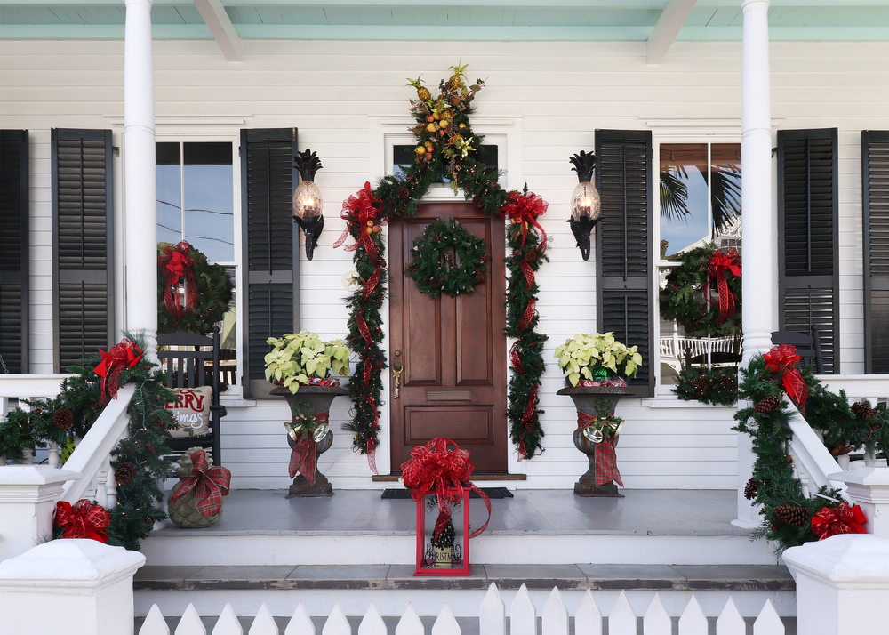 A porch covered in Christmas decoration on Key West